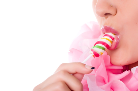 jabot: young woman in pink jabot with colored lollipop