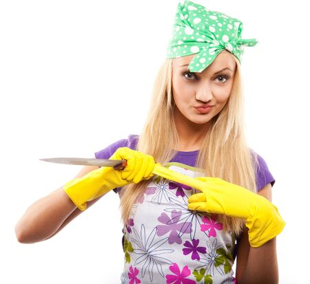 tucker: young beautiful housewife in rubber yellow gloves with knife