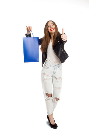 Young model holding shopping bag and showing it`s very good