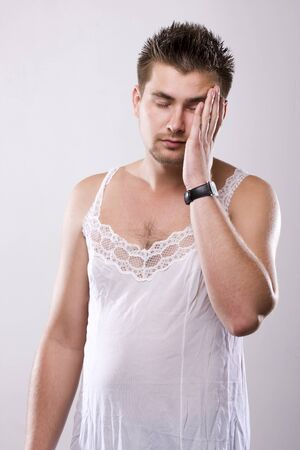 Man in woman`s pyjamas, tired and want to sleep