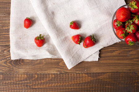 srawberries: Full glass bowl of fresh ripe srawberries and kitchen towel with delicious strawberries on it