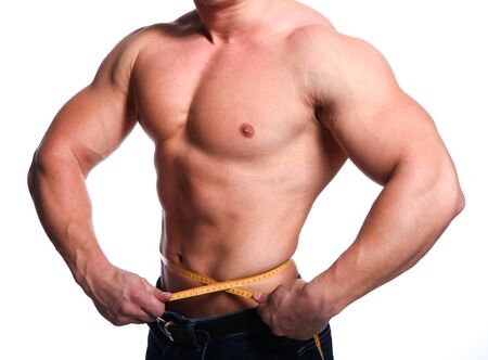 Strong young body of athlete man with centimeter