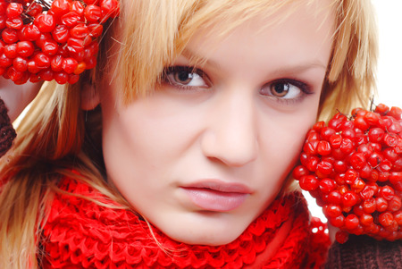 portrait of woman in scarf with red berries Stock Photo