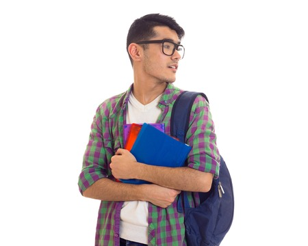 Young man with backpack and books Stock Photo