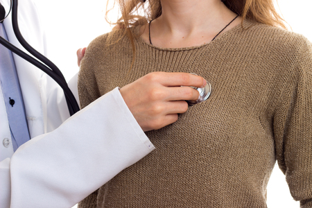 Doctor listening heartbeat of the woman Stock Photo