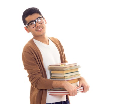 Young man in glasses with books Stock Photo