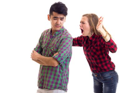Young couple in plaid shirts arguing