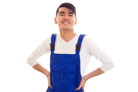 Young man in blue overall