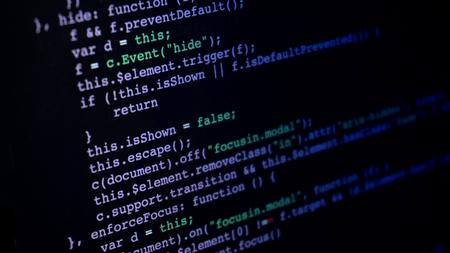 Programming script application code running down a computer screen Stock Photo