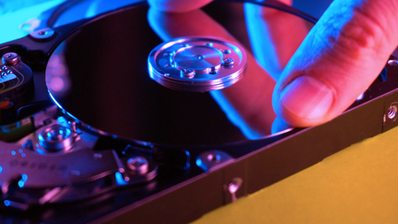 Man holding hdd storage and repairing it