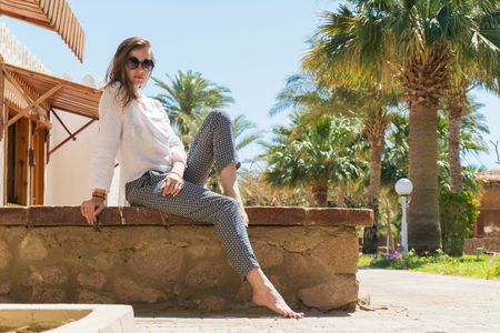 Pretty woman meditating on resort in summer on vacation Imagens