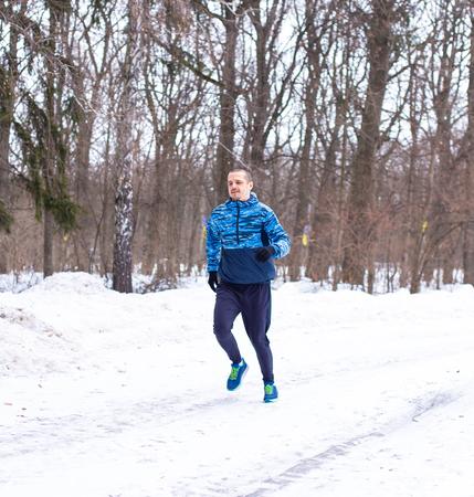 Outdoor winter running. Man runner do his training