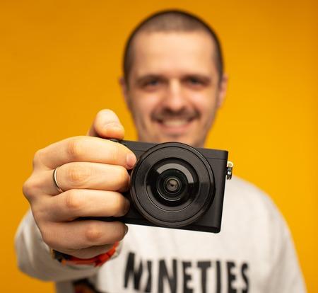 Closeup photo of camera in hand of man photographer Stock Photo