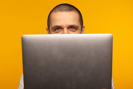 Half of head of man freelancer or programmer looking from laptop