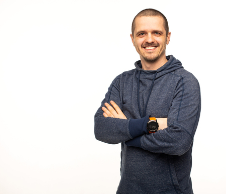 Man smiling and looking in camera with crossed hands