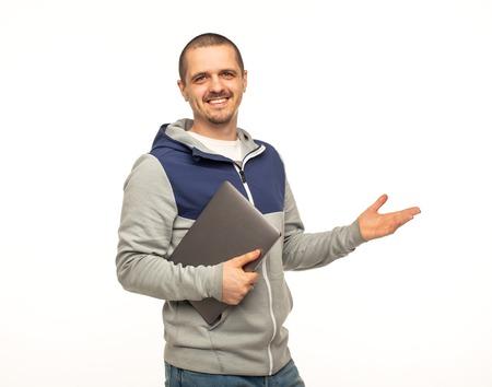 Man freelancer or coder holding laptop and smiling