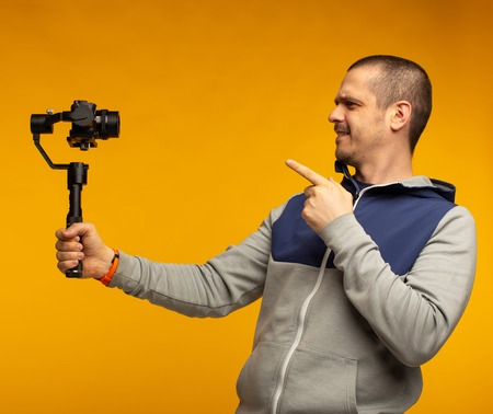 Man video blogger recording video and telling something for his audience