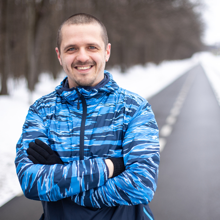 Man sportsman runner looking in camera and smiling Stock Photo