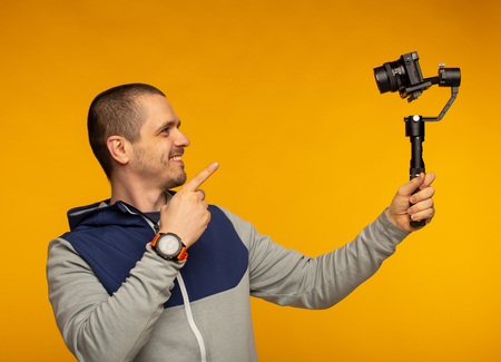 Man video blogger pointing in camera and filming hisself