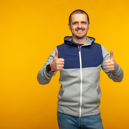 Happy man show two hands with thumbs up Stock Photo