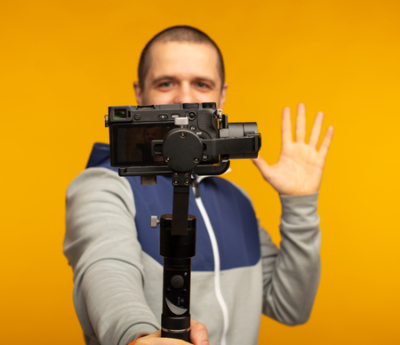 Man video blogger filming video about himself