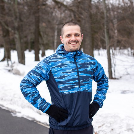 Smiling man after outdoor workout or running