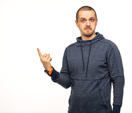 Man in hoodie pointing on something with shoked face
