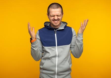 Happy laughting emotional man weared in hoodie Stock Photo
