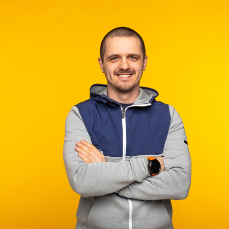 Man standing in hoodie and looking in camera and smiling Stock Photo