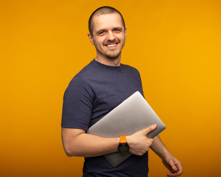 Man developer or freelancer or designer holding laptop