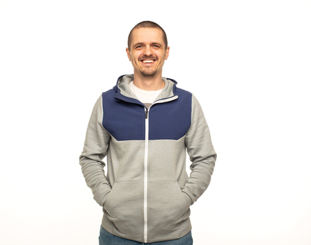 Man in hoodie standing at white background
