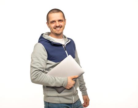 Freelancer man holding laptop and smiling in camera