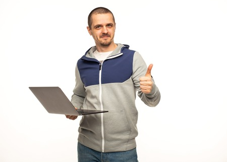 Man freelancer show thumbs up and holding laptop in hands