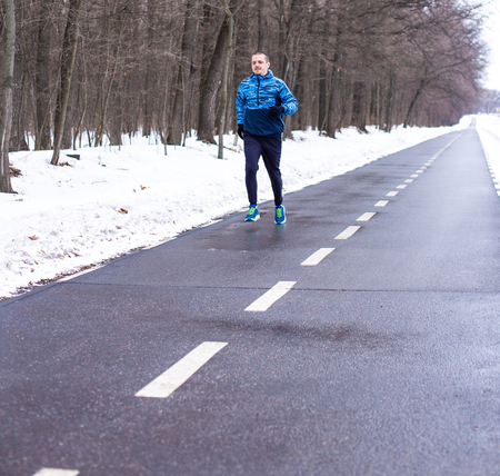 Man runner running on special track for runners Stock Photo