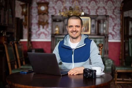 Man freelancer blogger looking in camera and smiling