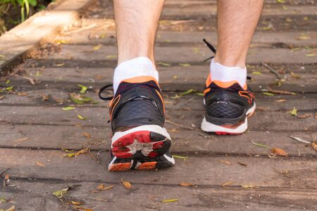 View on back of sneakers of man who preparing to run
