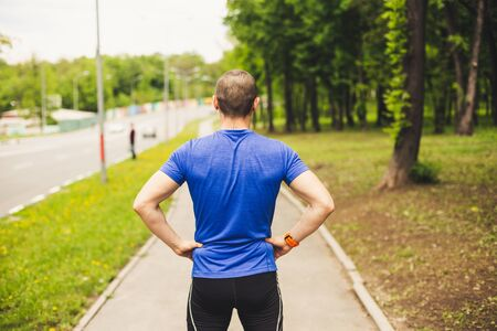 Back of man who preparing for hard run workout Stock Photo