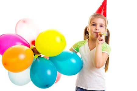 Little happy girl celebrating birthday with multicolor ballons Standard-Bild