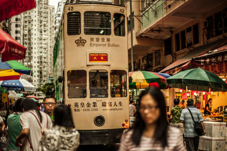 Hong Kong, China - 7 July, 2013: Tram and busy street in the North Point district of Hong Kong Redactioneel