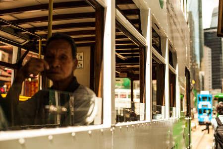 Hong Kong, China - 7 July, 2013: Passenger on the lower deck of a double decker tram in Causeway Bay district in Hong Kong Sajtókép