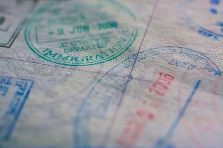 Passport stamps with focus on immigration Фото со стока