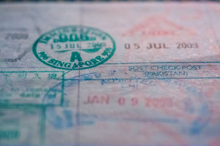 Passport stamps with focus on Singapore