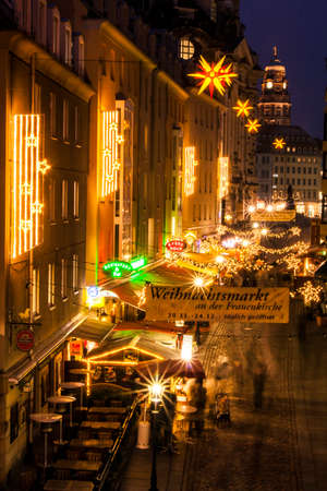 Dresden, Germany - 2 Jan. 2008: Christmas market with people during the nighttime next to the Frauenkirche in Dresden Editorial