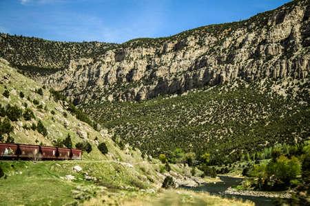 Freight train transporting good through the mountains