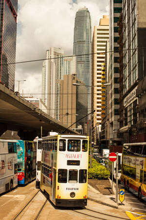 Hong Kong, China - 7 July, 2013: Tram making a turn in Central District in Hong Kong on a sunny day Redactioneel