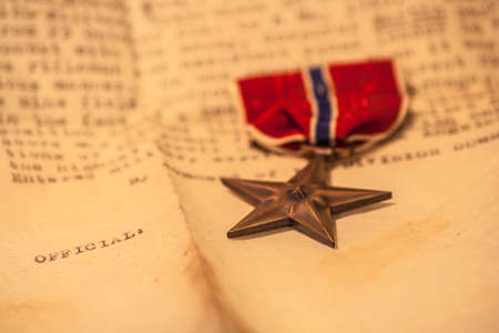 A Bronze Star and commendation, an American military service medal for heroism and bravery in active combat