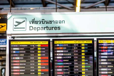 editorial - departures board inside the terminal at bangkok international airport. bangkok, thailand