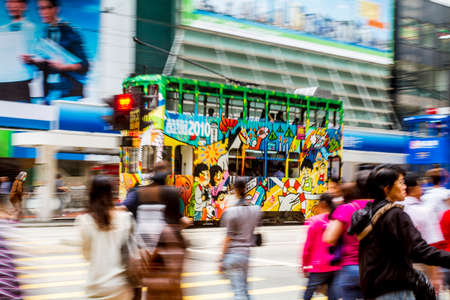 doubledecker: Hong Kong, China - 6 April, 2010: Double deck tram on a busy street in Causeway Bay district of Hong Kong