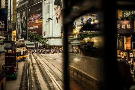 Hong Kong, China - 7 July, 2013: Busy street crossing viewed from a tram in Causeway Bay, Hong Kong