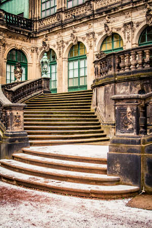 Stone stairway covered in snow at the Zwinger in Dresden, Germany